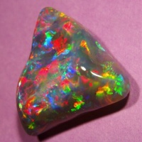 Opal with triangular shape and baroque face