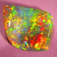 Opal with freeform shape and undulating face